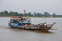 Phnom Penh, Cambodia. Sunset cruise to the confluence of Tonle Sap and Mekong river.<br /> Ferry at Areyksat Ferry Dock.
