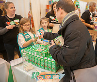 Girl Scouts mark the start of National Girl Scout Cookie Weekend in Vanderbilt Hall in Grand Central Terminal in New York on Friday, February 7, 2014. Exuberant scouts filled the hall selling their cookies in the world's largest girl-led business. Girl Scout Cookies are 97 years old this year and the kick-off weekend is anxiously awaited by cookie-lovers in need of Samoas, Thin Mints, Trefoils and other tasty baked goods. The Girl Scout Cookie Program teaches girls essential lives skills, goal setting, money management, business ethics, decision making, and people skills enabling them to go forward and be successful in adulthood.  (© Richard B. Levine)