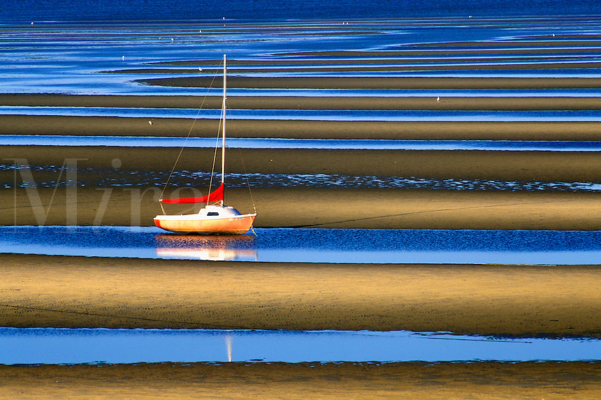 Sailboat anchored in tidal flats, Cape Cod Bay