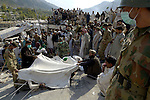 Following an October 8, 2005, earthquake, bodies are removed from the rubble in the devastated town of Balakot.