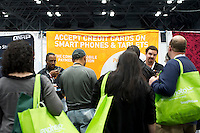A booth at a trade show promotes their mobile credit card processing system, PayAnywhere, in New York on Thursday, October 25, 2012.   (© Frances M. Roberts)