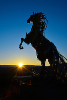 Whitehorse metal horse sculpture in the sunrise