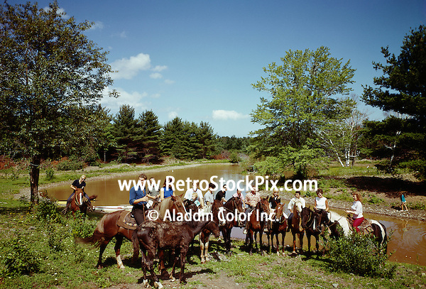 Ballwick Estate. Large group on horses gather by a stream