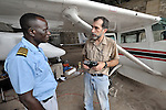 Stephen Quigg (right), a United Methodist missionary assigned to Mission Safety International, consults with pilot Jacques Umembudi Akasa, also a United Methodist missionary, in the hangar of Wings of Caring Aviation in Kananga, Congo. The program is sponsored by the United Methodist Church.