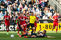 Jeff Parke (31) of the Philadelphia Union goes for a tackle on Justin Braun (17) of Toronto FC during a Major League Soccer (MLS) match at PPL Park in Chester, PA, on April13, 2013.