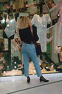 "April 27, 1990, Rome, Italy. Photographing for the book ""One day in the life of Italy"", this is an exploration of Rome. Shopping Center: Cinecitta 2. People are working and shopping."