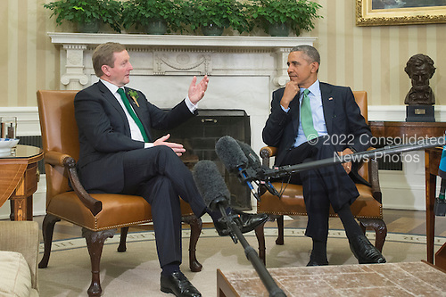 US President Barack Obama (R) listens to acting Prime Minister (Taoiseach) of Ireland Enda Kenny (L) deliver brief remarks to members of the news media following their bilateral meeting in the Oval Office of the White House, in Washington, DC, USA, 15 March 2016.<br /> Credit: Michael Reynolds / Pool via CNP