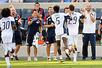 Marko Perovic (29) of the New England Revolution celebrates scoring the game tying goal with teammates. The Philadelphia Union and the New England Revolution  played to a 1-1 tie during a Major League Soccer (MLS) match at PPL Park in Chester, PA, on July 31, 2010.