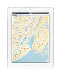 Apple iPad 2 tablet computer with a map of New York by Google Maps on its display. Isolated with clipping path on white background.