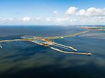 Nederland, Friesland, Gemeente Wonseradeel, 16-04-2012; Afsluitdijk ter hoogte van Kornwerderzand, gezien naar de kust van Friesland. Op het voormalig werkeiland liggen de Lorentzsluizen, een complex van spuisluizen en schutsluizen. De spuisluizen (uitwaterende sluizen) lozen van het IJsselmeer op de Waddenzee (links). De sluizen worden beschermd door kazematten (bunkers). .Enclosure Dam at the height of Kornwerderzand seen in the direction of the coast of Friesland. On the former work island the Lorentz locks, a complex of sluices and locks. The sluices sluice surplus water to the Wadden sea (l). The locks are protected by bunkers..luchtfoto (toeslag), aerial photo (additional fee required).foto/photo Siebe Swart