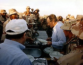 Saudi Arabia - November 22, 1990 -- United States President George H.W. Bush shares the holiday meal with United States military personnel in Saudi Arabia on Thanksgiving Day, November 22, 1990..Credit: Ed Bailey - DoD via CNP