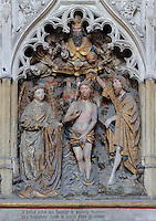 The baptism of Jesus by St John, polychrome high relief in the second row on the North side of the Gothic choir screen in the North ambulatory, 1490-1530, commissioned by canon Adrien de Henencourt and made by the sculptor Antoine Ancquier, depicting the life of St John the Baptist, at the Basilique Cathedrale Notre-Dame d'Amiens or Cathedral Basilica of Our Lady of Amiens, built 1220-70 in Gothic style, Amiens, Picardy, France. Amiens Cathedral was listed as a UNESCO World Heritage Site in 1981. Picture by Manuel Cohen