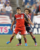 Toronto FC midfielder Andrew Wiedeman (32) attempts to control a throw in as New England Revolution defender Kevin Alston (30) defends. In a Major League Soccer (MLS) match, Toronto FC defeated New England Revolution, 1-0, at Gillette Stadium on July 14, 2012.