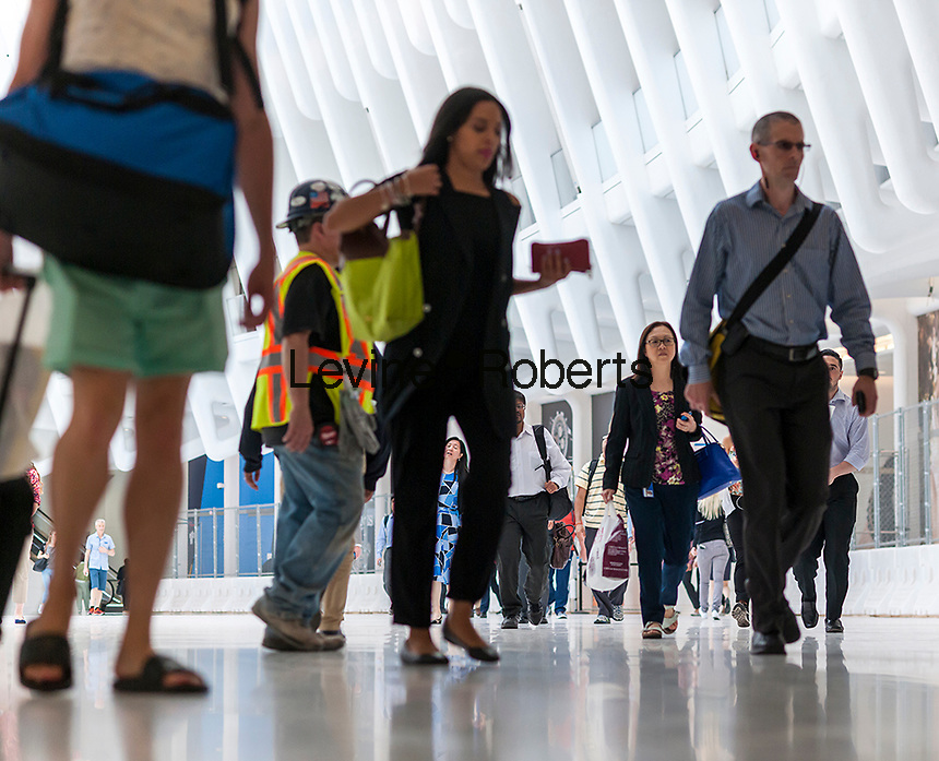 Armies of commuters travel through the World Trade Center Transportation Hub on their way home, some of which will invariably not return to work the next day, getting an early start to the Memorial Day weekend on Thursday, May 26, 2016. Memorial Day is considered the unofficial start of summer.  (© Richard B. Levine)