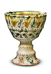 Stock photo of a Goblet of the brown green Sgraffito ware Medieval period 15 century Cyprus Wine Museum Vertical Isolated silhouette over white background with a clipping path