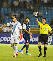 Guatemala's (14) Luis Rodriguez complaints about a foul called while the USA's (9) Herculez Gomez looks on as the United States played Guatemala at Estadio Mateo Flores in Guatemala City, Guatemala in a World Cup Qualifier on Tue. June 12, 2012.