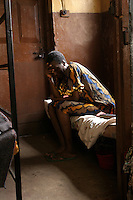 One of the older detainees sits on a bed in the 'City of Rest', a rudimentary counselling and mini rehabilitation centre for recovering drug addicts, alcoholics and traumatised or delinquent youths.  It is run by a pastor who attributes the centre's success to the extensive rest, food and prayer.