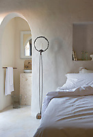 As in a traditional Moroccan riad the house is full of alcoves and archways and in this bedroom the bathroom is situated in an adjacent space through the arch