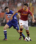 Calcio, Serie A: Roma vs Sampdoria. Roma, stadio Olimpico, 26 settembre 2012..AS Roma defender Nicolas Burdisso, of Argentina, is challenged by Sampdoria forward Nicola Pozzi, left, during the Italian Serie A football match between AS Roma and Sampdoria at Rome's Olympic stadium, 26 September 2012..UPDATE IMAGES PRESS/Riccardo De Luca