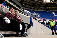 Colorado Rapids head coach Pablo Mastroeni talks with head athletic trainer Jaime Rojas. The New York Red Bulls and the Colorado Rapids played to a 1-1 tie during a Major League Soccer (MLS) match at Red Bull Arena in Harrison, NJ, on March 15, 2014.