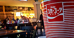 A plastic cup with the Coca Cola symbol is seen in a mall in Jersey City. Coca Cola Company management will discuss its final quarterly results for 2011 on February 7th at the New York Stock Exchange, New York, USA.  January 3, 2012. Photo by Eduardo Munoz Alvarez / viewpress