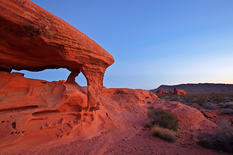 Predawn light falls on Piano Arch in the Valley of Fire State Park in Nevada, USA
