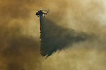 Greeley Hill, California-- July 30, 2008-Telegraph Fire-Wildfires Threaten Yosemite National Park.Erickson Sky crane drops water on the leading edge of Telegraph fire.  Division L is on the leading edge of the fire and is threatening Greeley Hill..Photo by Al GOLUB/Golub Photography