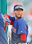 8 March 2012: Boston Red Sox infielder Dustin Pedroia awaits his turn in the batting cage prior to a game againstprior to a Spring Training game against the St. Louis Cardinals at Roger Dean Stadium in Jupiter, Florida. The Cardinals defeated the Red Sox 9-3 in Grapefruit League action. Mandatory Credit: Ed Wolfstein Photo