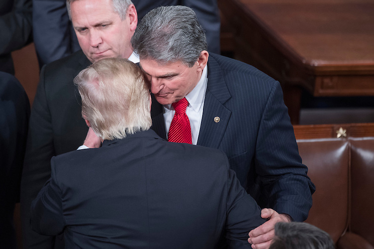 UNITED STATES - FEBRUARY 28: President Donald Trump greets Sen. Joe Manchin, D-W.Va., after addressing a joint session of Congress in the Capitol's House Chamber, February 28, 2017. (Photo By Tom Williams/CQ Roll Call)