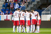 New York Red Bulls huddle prior to playing Sporting Kansas City. Sporting Kansas City defeated the New York Red Bulls 1-0 during a Major League Soccer (MLS) match at Red Bull Arena in Harrison, NJ, on April 17, 2013.