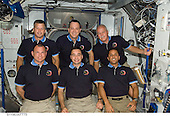 In Earth Orbit - March 24, 2009 -- STS-119 crewmembers pose for a group photo following a joint news conference in the Harmony node of the International Space Station while Space Shuttle Discovery remains docked with the station. From the left (bottom row) are NASA astronauts Tony Antonelli, pilot; Lee Archambault, commander; and Joseph Acaba, mission specialist. From the left (top row) are astronauts Steve Swanson, Richard Arnold and John Phillips, all mission specialists..Credit: NASA via CNP