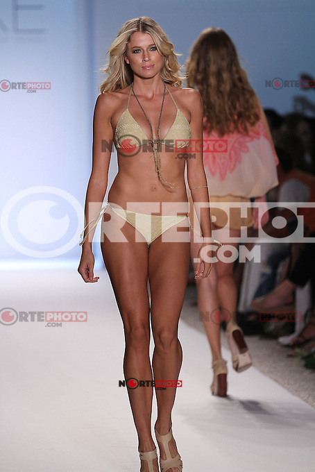 MIAMI BEACH, FL - JULY 17: A model walks the runway during the Luxe By Lisa Vogel show during Mercedes-Benz Fashion Week Swim at The Raleigh on July 17, 2011 in Miami Beach, Florida. (photo by: MPI10/MediaPunch Inc.)