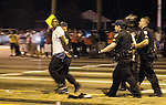 BATON ROUGE, LA -JULY 09: Baton Rouge police removed protesters that were arrested on July 9, 2016 in Baton Rouge, Louisiana. Alton Sterling was shot by a police officer in front of the Triple S Food Mart in Baton Rouge on July 5th, leading the Department of Justice to open a civil rights investigation. (Photo by Mark Wallheiser/Getty Images)