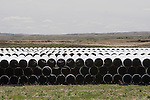 Pipe waiting for installation sits in a empty field near Consort, Alberta. The pipe is potentially destined for the Keystone XL project or the proposed Energy East project. (Credit: Robert van Waarden - http://alongthepipeline.com)