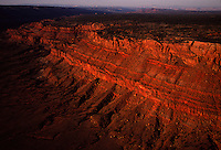 Sandstone-capped escarpment of the Vermilion Cliffs tumbles 3,000 feet to the Grand Canyon in northern Arizona. Vast scale makes the Colorado River's down-cutting appear as a series of narrow, winding incisions near Marble Canyon.  The remote 293,000 acre monument features a majestic grand terrace rising at the edge of the desert of the Paria Plateau.