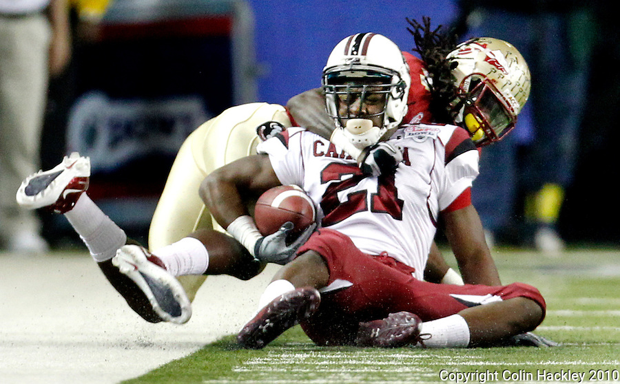 ATLANTA, AG 12/31/10-FSU-SC FB10 CH-Florida State's Terrance Parks makes a touchdown-saving tackle on South Carolina's Marcus Lattimore during first half action Friday at the Chick-fil-A Bowl in Atlanta..COLIN HACKLEY PHOTO