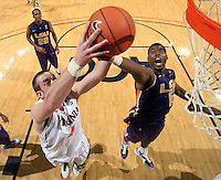 Jan. 2, 2011; Charlottesville, VA, USA; Virginia Cavaliers forward Will Regan (4) reaches for the loose ball with LSU Tigers forward Malcolm White (5) during the game at the John Paul Jones Arena. Virginia won 64-50. Mandatory Credit: Andrew Shurtleff