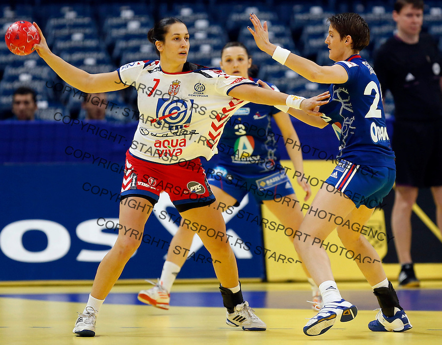 BELGRADE, SERBIA - DECEMBER 13: Andrea Lekic (L) of Serbia is challenged by Raphaelle Tervel (R) of France during the Women's European Handball Championship 2012 Group I main round match between Serbia and France at Arena Hall on December 10, 2012 in Belgrade, Serbia. (Photo by Srdjan Stevanovic/Starsportphoto.com)