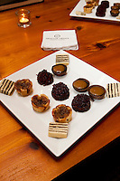 Raisan butter tarts, cranberry gingerbread upside down cakes, chocolate silk tarts, and in the corners, Vinatarta. January 14, 2012. © Allen McEachern.