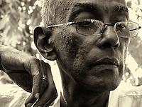 Mohan Ariyaratne by the tank at Kataragama on a visit to see Matara Swami.