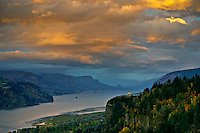Looking east down the Columbia River at sunset.  Coast on the left is Washington State.   On the Right is Chanticleer Point in Oregon.  Sun was setting behind us over the Pacific and the light was bouncing off the clouds.