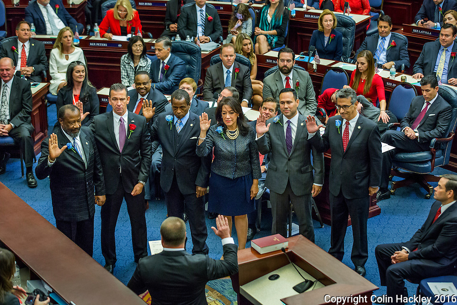 TALLAHASSEE, FLA. 11/22/16-Rep. Barrington Russell, D-Lauderdale Lakes, left, Rep. Bob Rommel, R-Naples, Rep. Roy Hardemon, D-Miami, Rep. Daisy Baez, D-Coral Gables, Rep. Bob Rommel, R-Naples, and Rep. Robert Asencio, D-Miami take the oath of office from <br /> Judge Nicholas Thompson during the organizational session of the legislature at the Capitol in Tallahassee.<br /> <br /> COLIN HACKLEY PHOTO