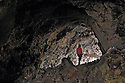 ID00454-00...IDAHO - Exploring Indian Tunnel, a lava tube in Craters of the Moon National Park and Preserve.