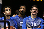 13 March 2015: Duke players Tyus Jones (left), Matt Jones, and Grayson Allen (right) wait for the prior game to end. The Notre Dame Fighting Irish played the Duke University Blue Devils in an NCAA Division I Men's basketball game at the Greensboro Coliseum in Greensboro, North Carolina in the ACC Men's Basketball Tournament semifinal game. Notre Dame won the game 74-64.