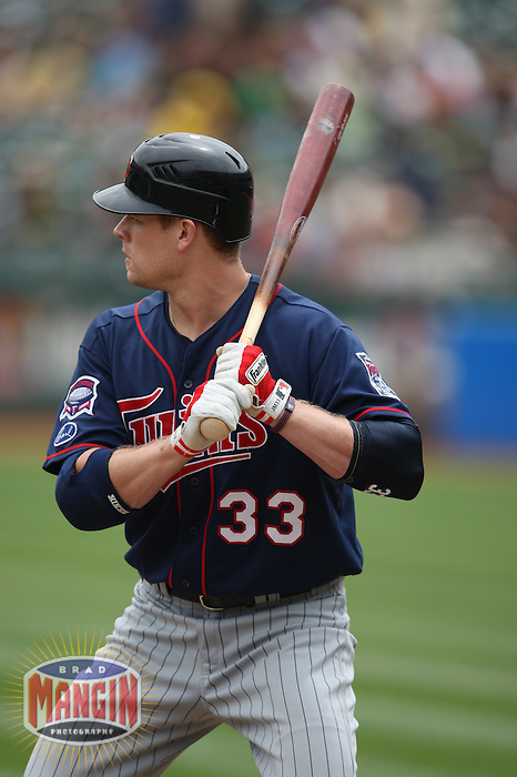 OAKLAND, CA - JULY 22:  Justin Morneau #33 of the Minnesota Twins bats against the Oakland Athletics during the game at the Oakland-Alameda County Coliseum on July 22, 2009 in Oakland, California. Photo by Brad Mangin