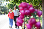 Roy and Penny Lave enjoy quiet time together while walking by the Neutra House in Los Altos. <br />