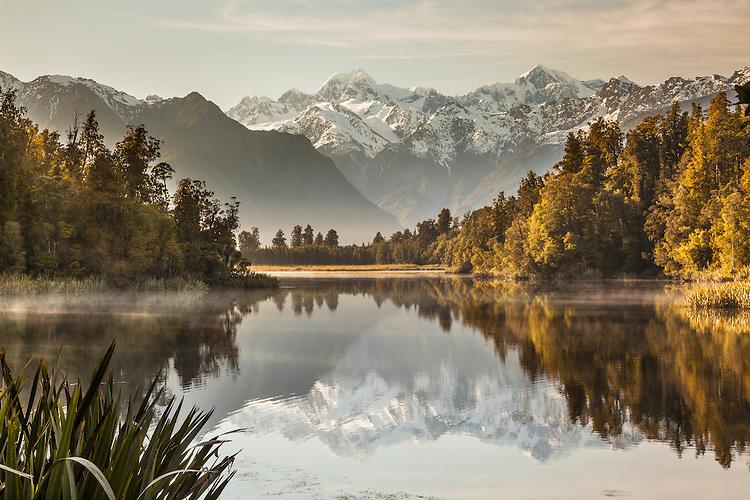 Misty morning at Lake Matheson,  South Westland / Westland Tai Poutini National Park New Zealand.