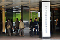 April 20, 2012, Tokyo, Japan - Olympus stockholders arrive at a Tokyo hotel where the camera maker holds an extraordinary meeting of its shareholders on Friday, April 20, 2012. .The scandal-tainted company is expected to face investor backlash over its nominees for the board of directors. The meeting came as Olympus attempted to rebuild its reputation following a $1.7 billion cover-up scandal, which sparked lawsuits and the arrest of company executives. (Photo by Natsuki Sakai/AFLO) AYF -mis-.