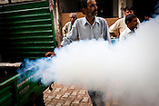 A civic worker fumigates the streets to prevent the spread of malaria and dengue fever in New Delhi, India.