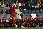 13 November 2009: NC State's Tyler Lassiter (12) and Boston College's Edvin Worley (right) challenge for a header. The North Carolina State University Wolfpack defeated the Boston College Eagles 1-0 at WakeMed Stadium in Cary, North Carolina in an Atlantic Coast Conference Men's Soccer Tournament Semifinal game.